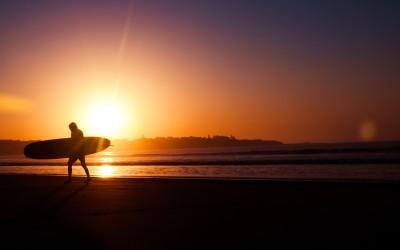 beach surfing at sunset
